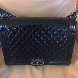 Chanel authentic black patent leather Boy bag.